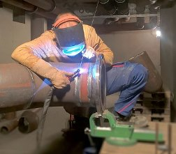 pipe welder at work in Wrangell AK