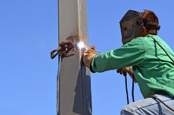Gustavus AK welder working on pole